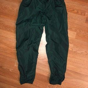 Nike track pants green